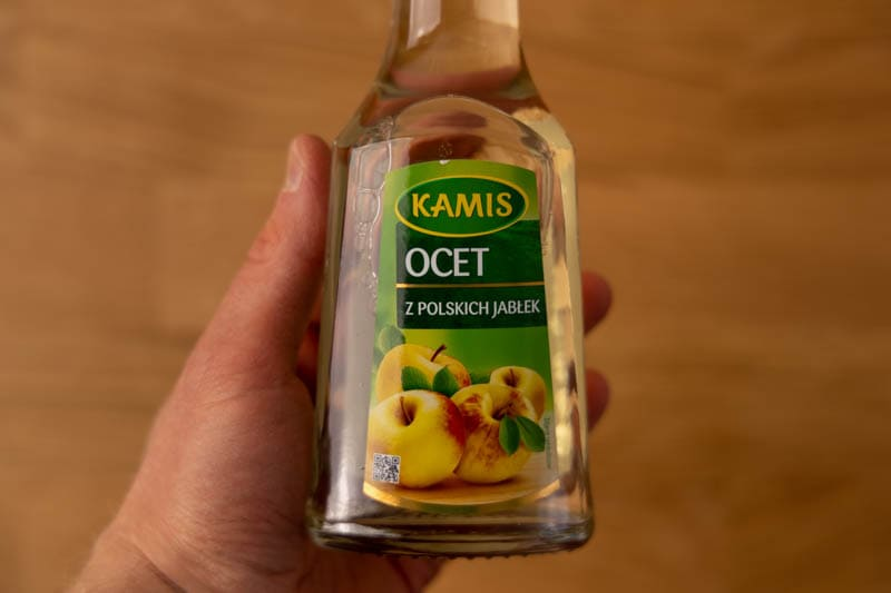 Apple cider vinegar in hand
