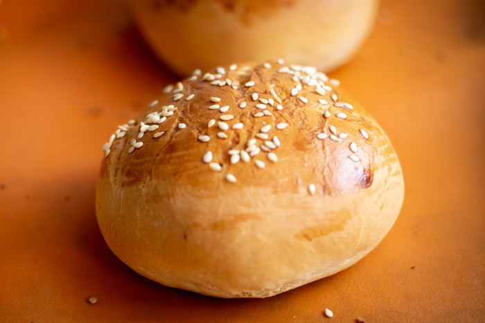 Baked bread rolls with sesame seeds on top