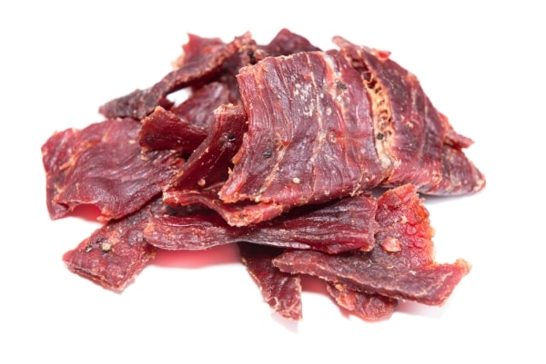A portion of Beef Jerky on white background