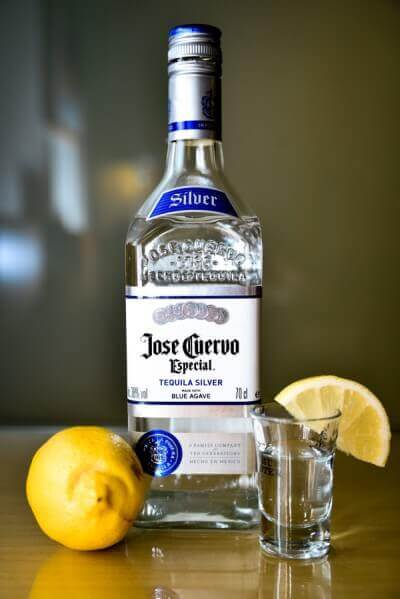 Botte of tequila with lemon