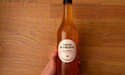 Bottle of kombucha in hand