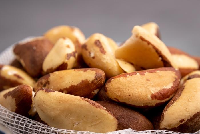 Brazil nuts in a mesh bag closeup