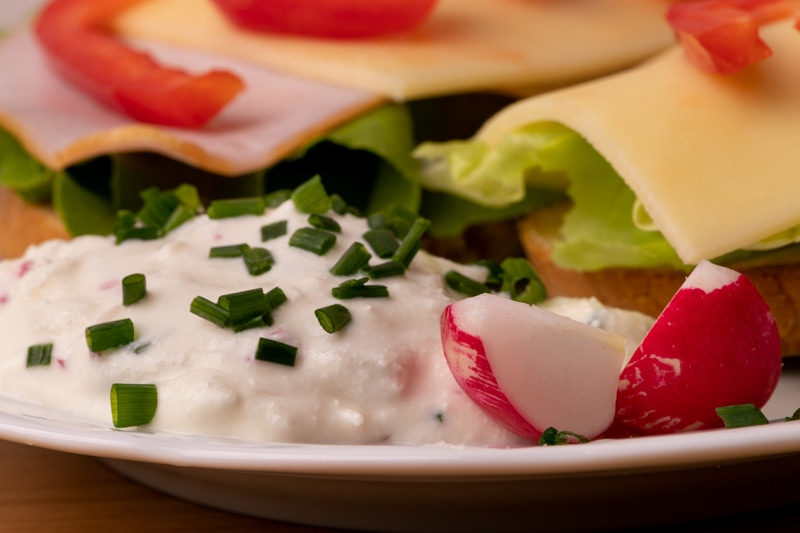 Bread and cream cheese with radishes