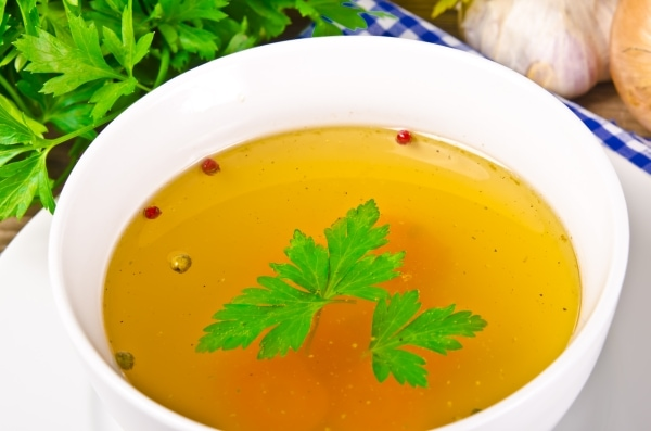 Broth in a white bowl