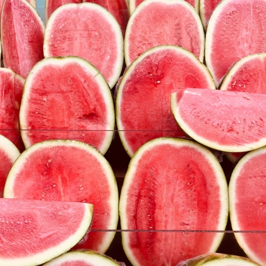 Bunch of halved and quatered watermelons