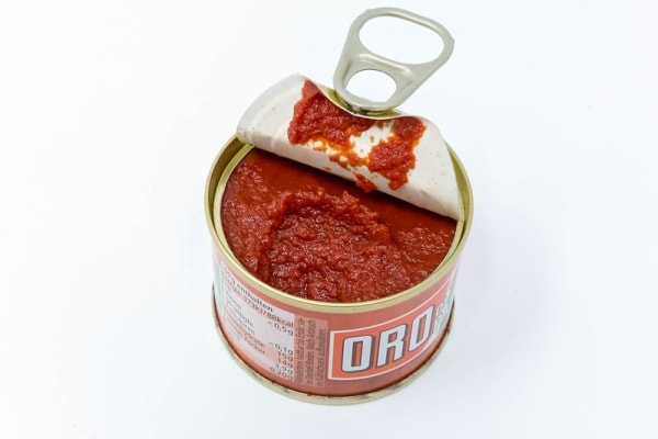 An open can of tomato paste