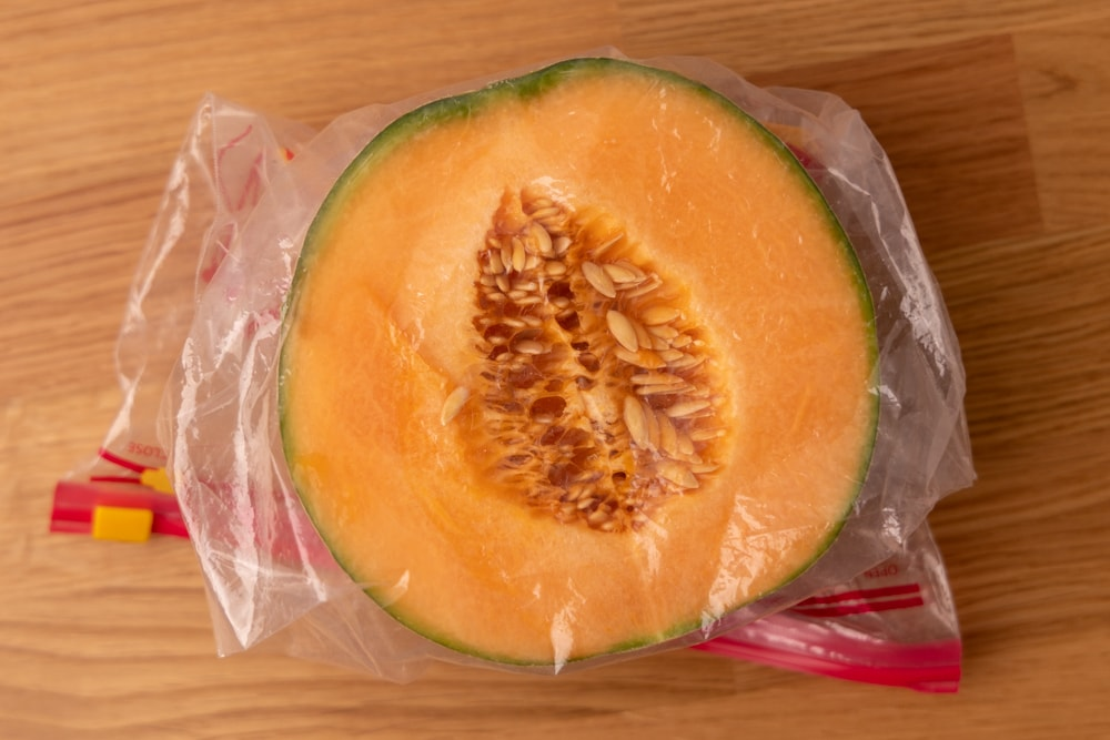Cantaloupe half in a freezer bag