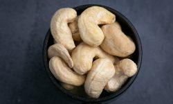 Cashews in a black scoop