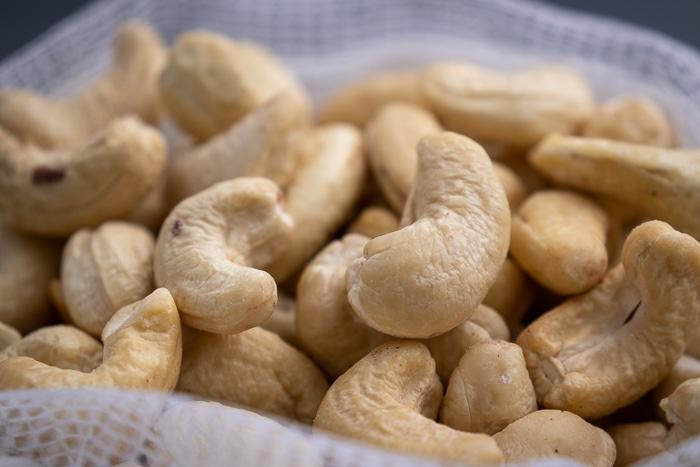 Cashews in a mesh bag closeup