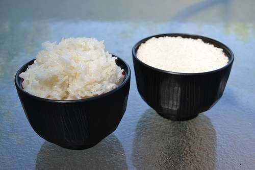 A cup of cooked and a cup of uncooked rice