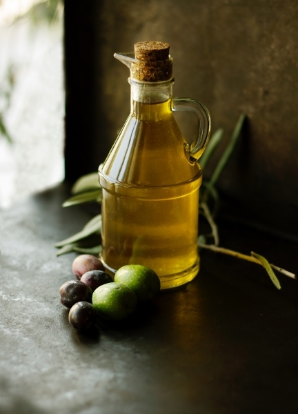Cordked glass bottle of olive oil