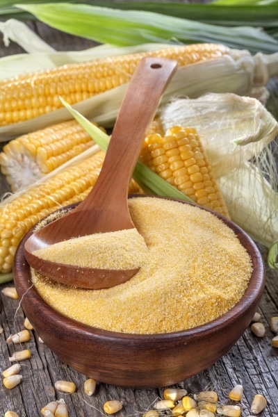 Corn grits in a wooden bowl