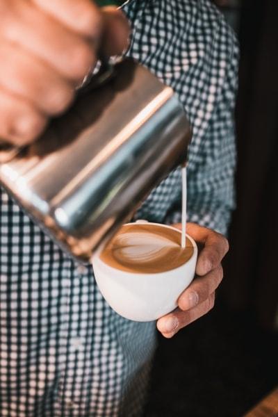 Creamer going into coffee