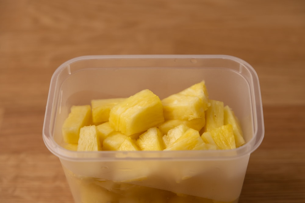 Cut up pineapple in a container