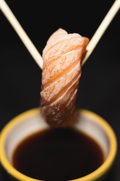 Dipping sushi in soy sauce