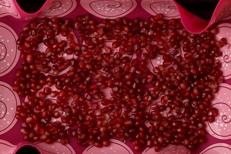 Dry pomegranate seeds ready for freezing