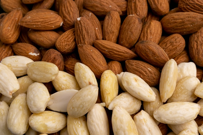 Equal parts unpeeled and peeled almonds