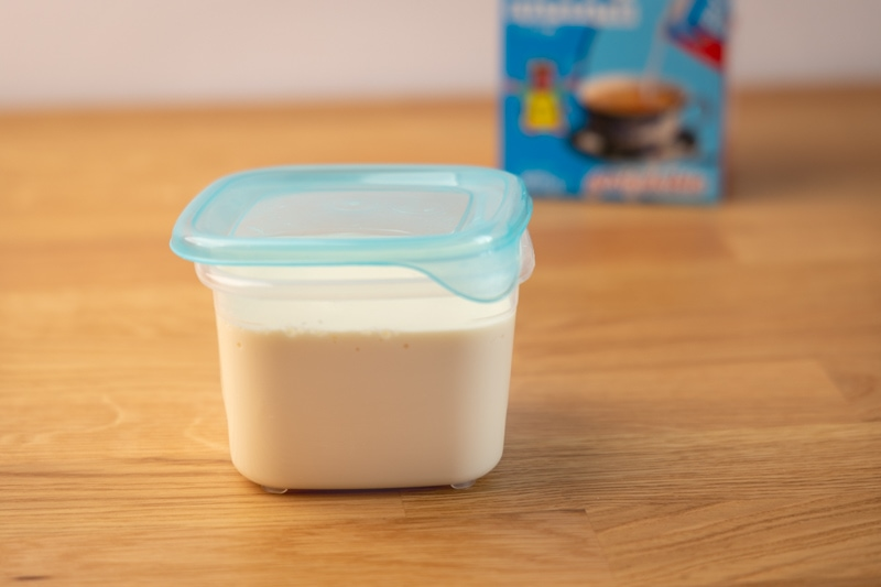 Evaporated milk in a container