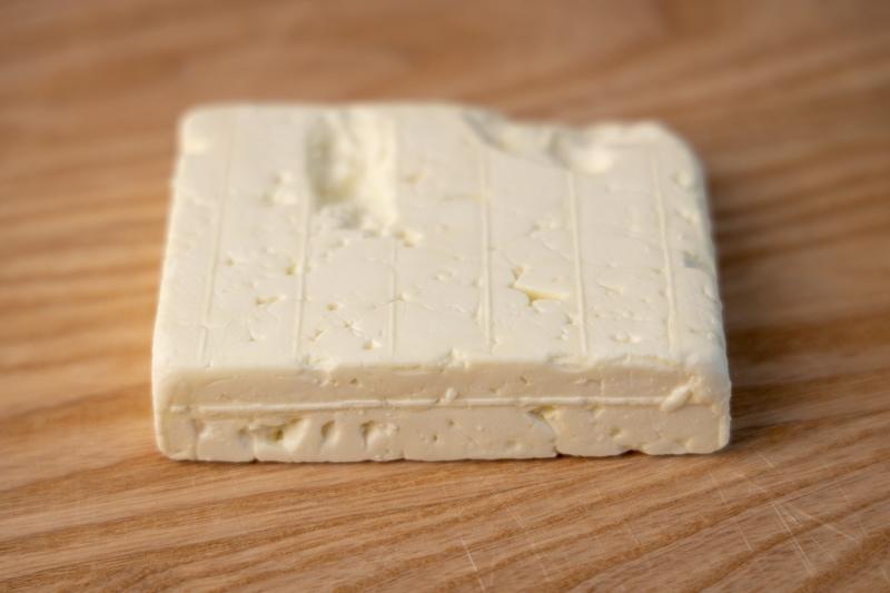 Feta cheese block on a cutting board