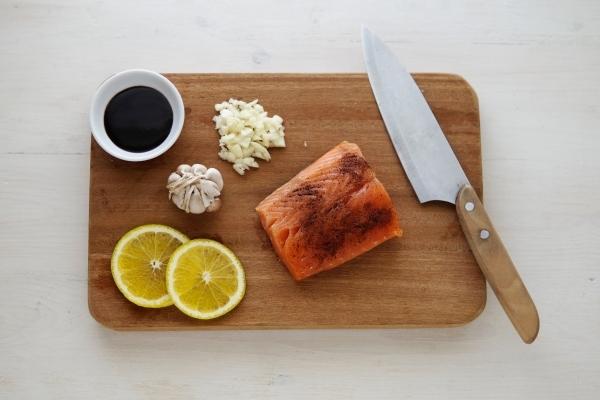 Fish, soy sauce, garlic, and lemon slices