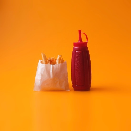 Fries and red squeeze bottle of ketchup