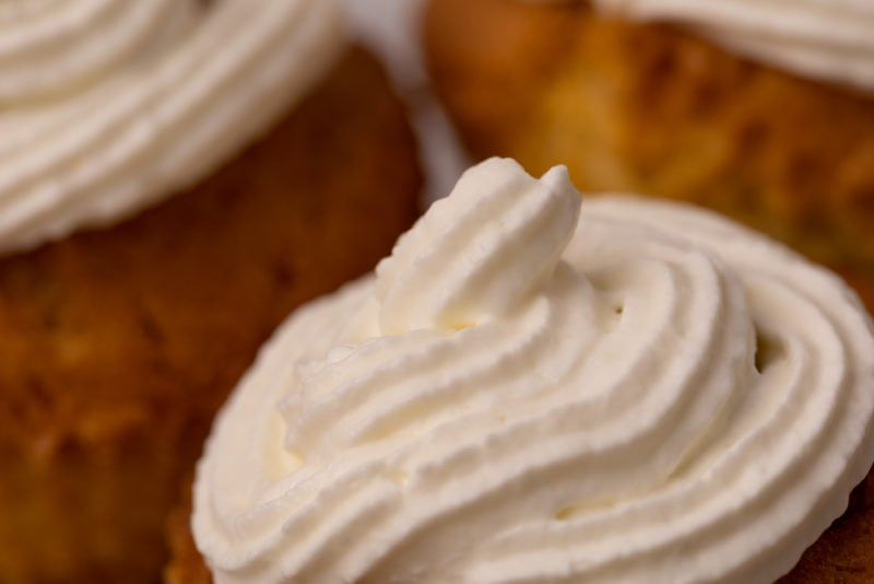Frosted cupcakes with whipped cream