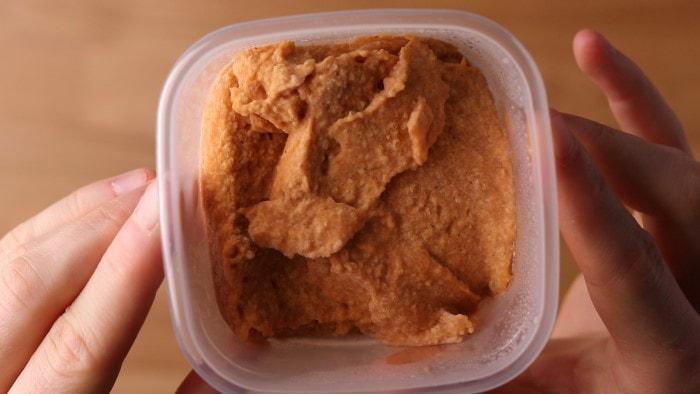 Frozen hummus in freezer container