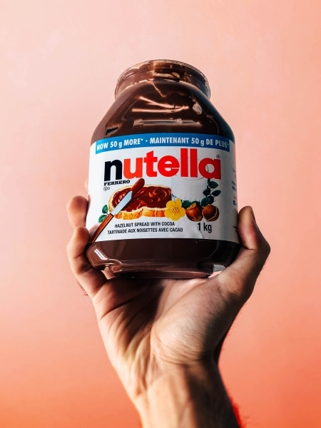 Person holding a jar of Nutella