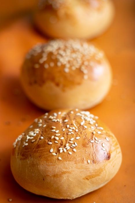 Line of baked bread rolls