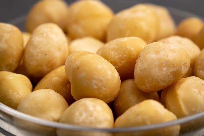 Macadamia nuts in a glass bowl closeup