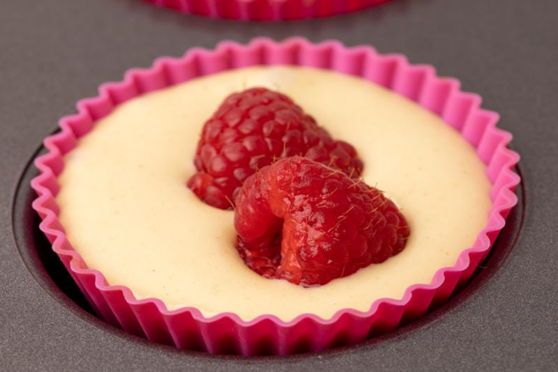 Muffin batter and two raspberries