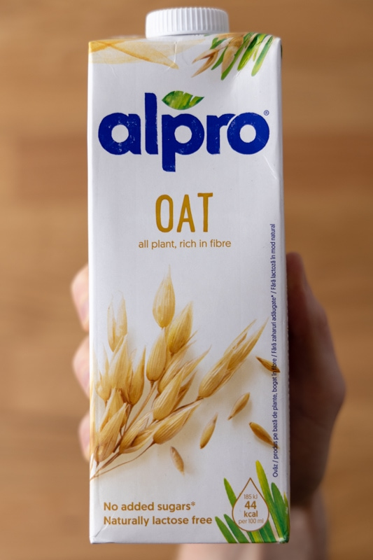 Oat milk in hand