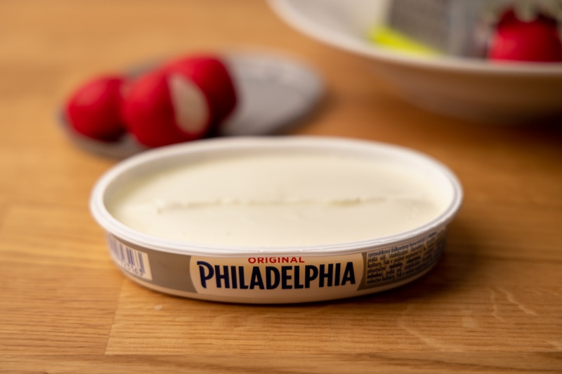 Opened cream cheese container
