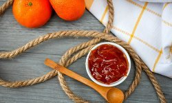 Orange Jam With Wooden Spoon Top View