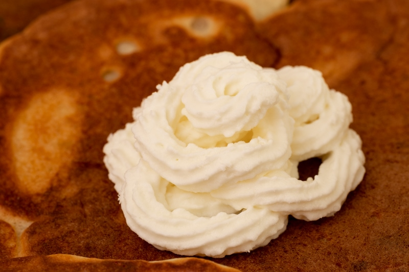 Pancake topped with whipped cream
