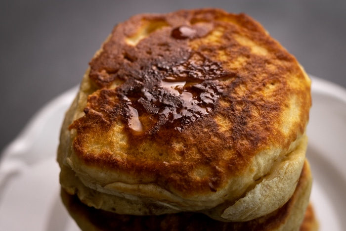 Pancake topped with maple syrup