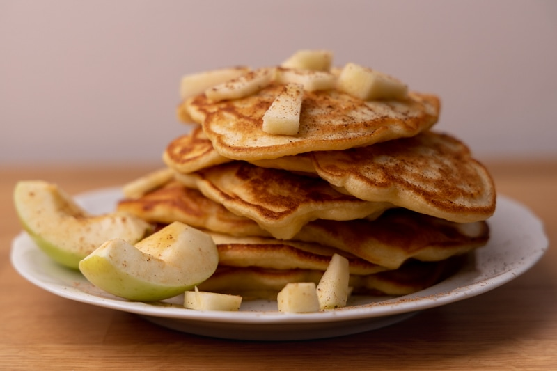 Pancakes topped with apples and cinnamon