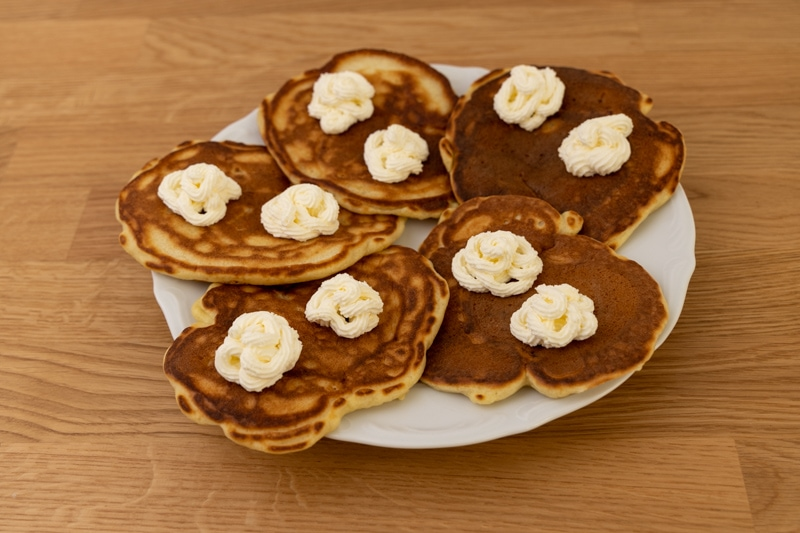 Pancakes topped with thawed whipped cream