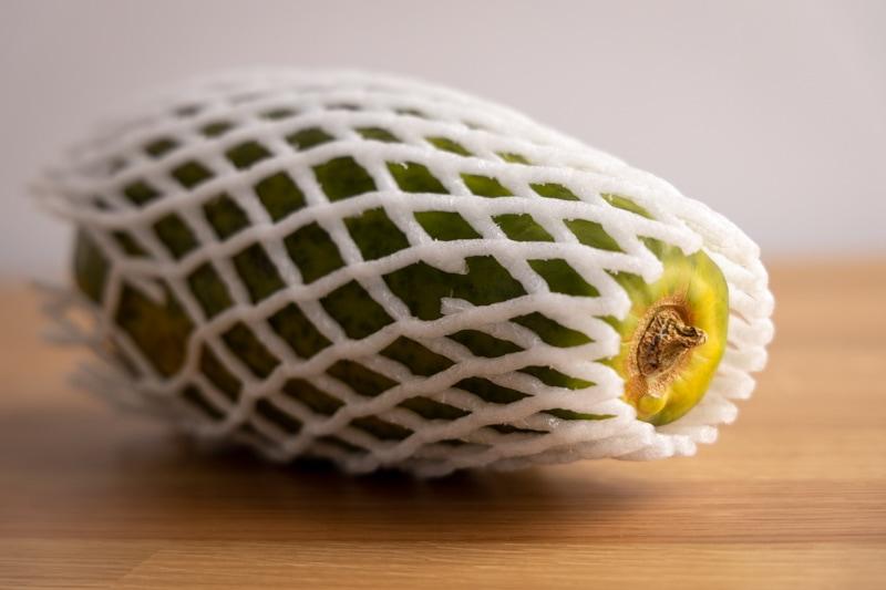 Papaya in a plastic foam packaging net