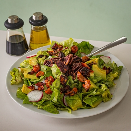 Pecan avocado salad with balsamic vinegar and olive oil sauces