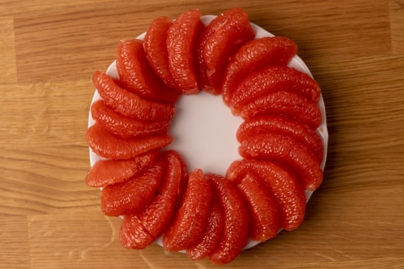 Peeled grapefruit in circle