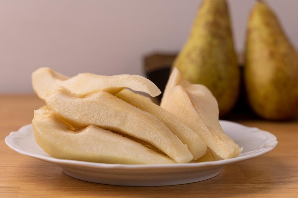 Peeled pears on a plate