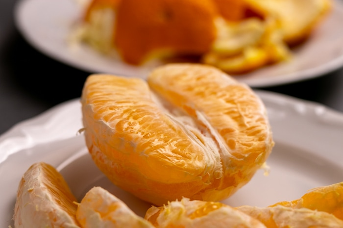Peeling an orange