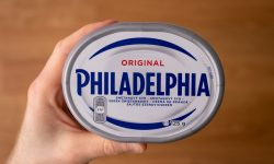 Philadelphia cream cheese in hand