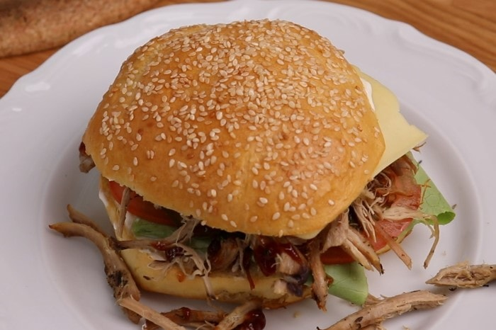 Prepared burger with thawed and reheated pulled pork