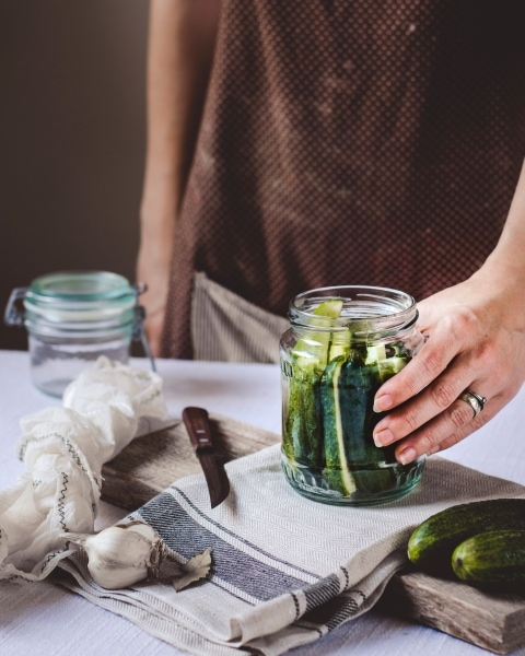 Prepping pickles in a mason jar
