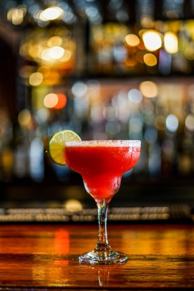 Red margarita on a bar table