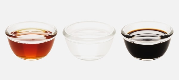 Bowls of red, white, and black vinegar