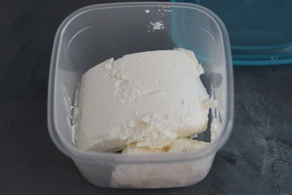 Ricotta portion in a container, prepard for freezing