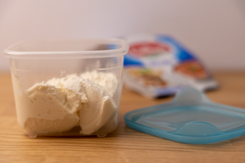Ricotta in a plastic container